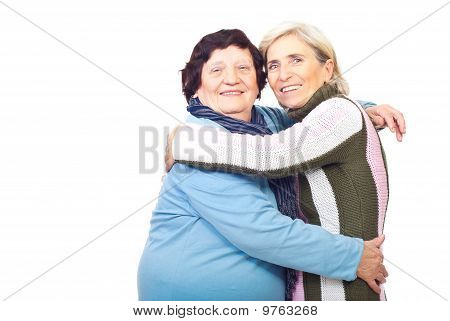 Elderly Mother And Senior Daughter Embrace