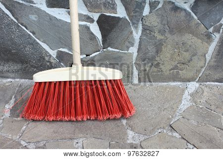 classic broom closeup on stone background