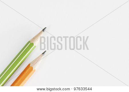 Two Isolated Pencils On Grayish White Bacground