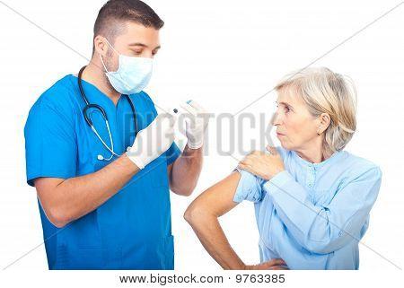 Doctor Man Preparing Syringe For Vaccination