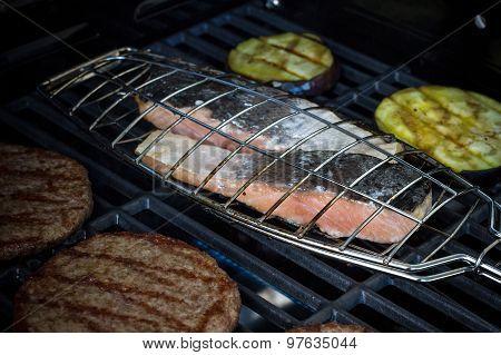 Salmon Steak, Hamburger Slices And Eggplant On Grill