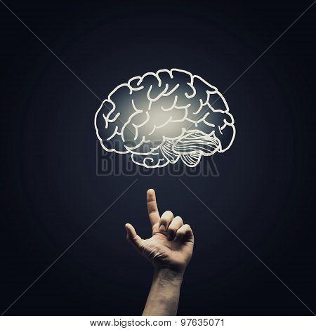 woman hold brain symbol on hand