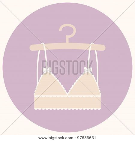Fashion bra in nude color on the hanger.