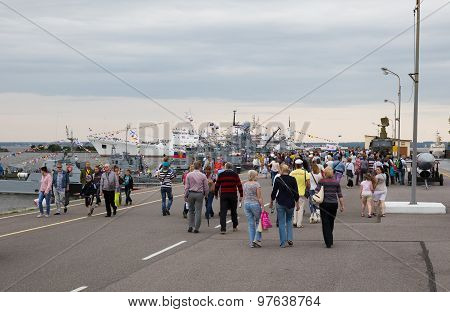 People Walk On The Pier