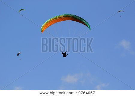 A Group Of Paragliders.
