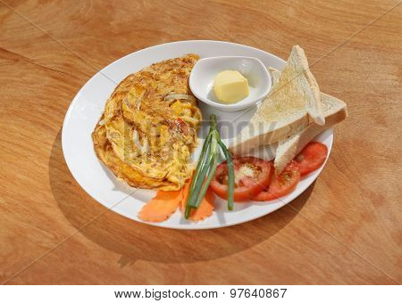 Vegetable Omelette On Wooden Table