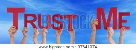 People Hands Holding Red Straight Word Trust Me Blue Sky
