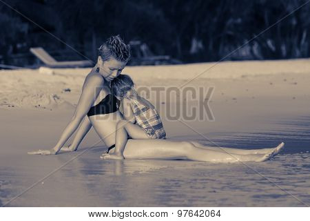 Young Mother Hugging Her Daughter At The Sea