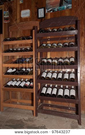 European Traditional Shelves With Wine Bottles