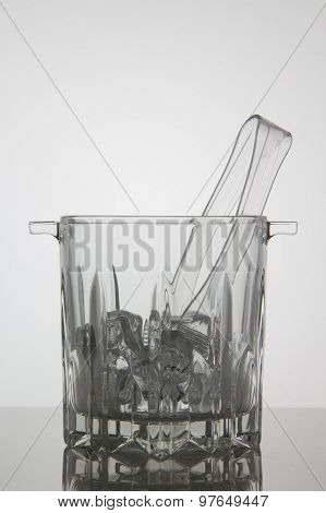 Glass ice bucket on white background