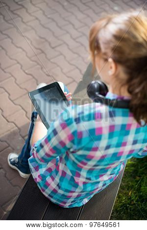 Beautiful young woman student with note pad. Outdoor student.