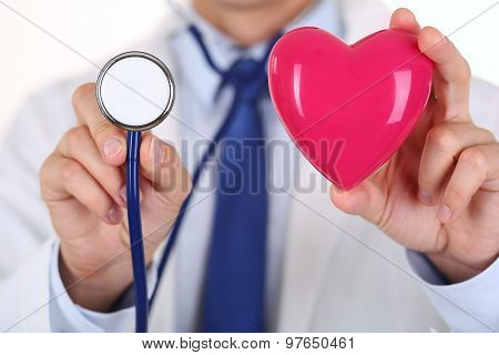 Male Medicine Doctor Holding Red Heart And Stethoscope