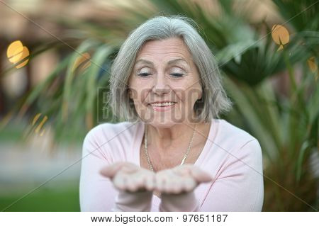 Older woman showing your product