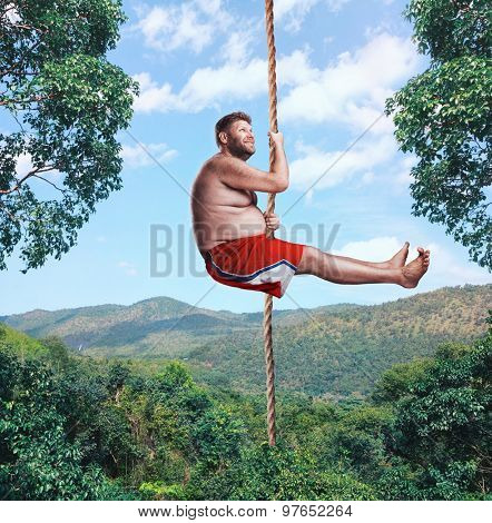 Man flying in the air by rope