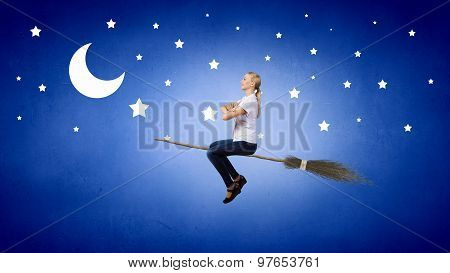 Girl on broom