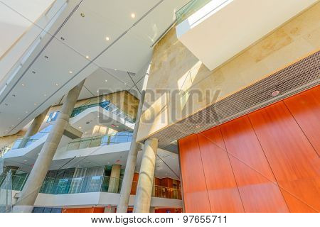 Painted in brown. Abstract fragment of the architecture of modern lobby, hallway of the luxury hotel, shopping mall, business center in Vancouver, Canada. Interior design.