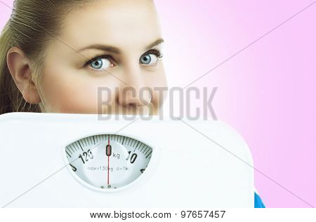 woman with floor scales, isolated against white background