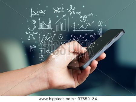 Hand holding smartphone with business scheme on it