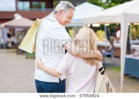 Adult couple shopping outdoor