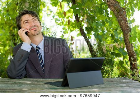 happy businessman with digital tablet, outdoors