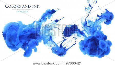 Acrylic colors and ink in water. Abstract unfocused background.