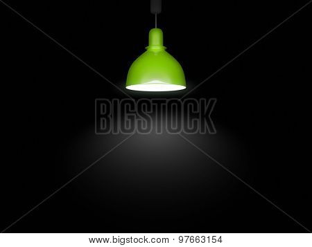 An image of a green lamp in front of a black background