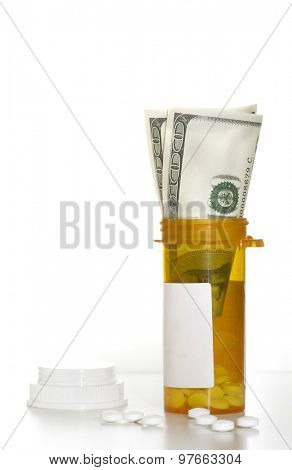 Prescription pills with dollar bills - cost of healthcare concept image