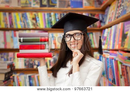 Happy Student with Graduation Cap Holding Books