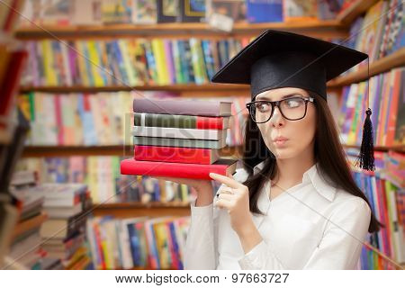 Surprised  Student with Graduation Cap Holding Books