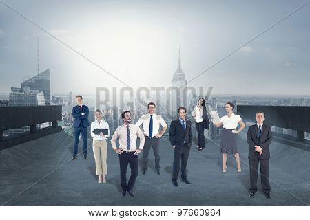 Business team against cityscape on the horizon