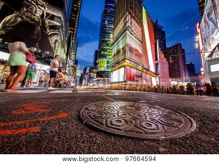 NEW YORK, NY, USA - June 12, 2015: Colorful intersection of 42nd Street and Times Square in New York City at night just after sunset