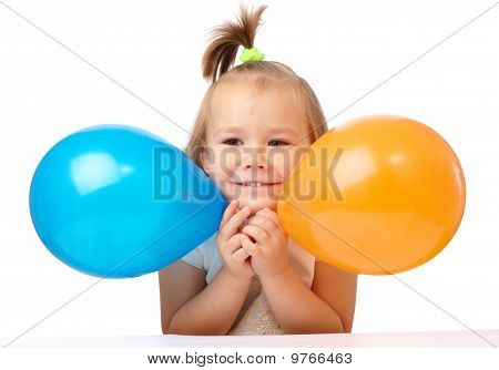 Cute Little Girl With Two Colored Balloons