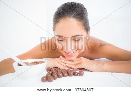 Beautiful brunette enjoying a chocolate beauty treatment at the health spa