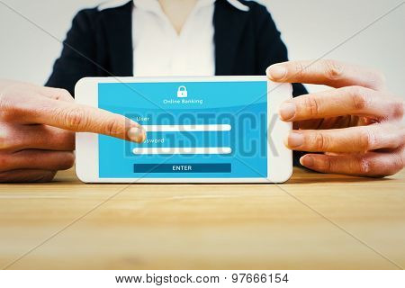 Businesswoman using her tablet pc against online banking