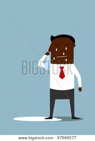 Depressed cartoon black businessman crying