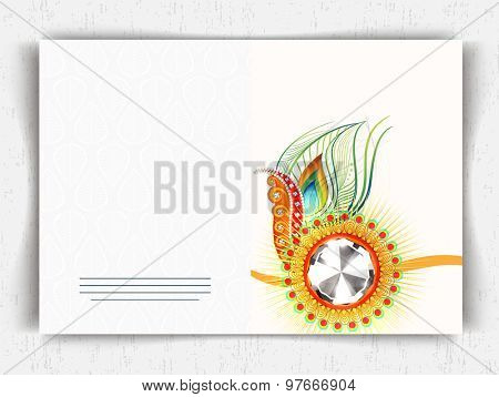 Shiny greeting card design decorated with colorful rakhi with peacock feather for Raksha Bandhan celebration.