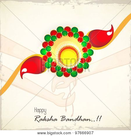 Creative colorful rakhi on stylish background for Indian festival of brother and sister love, Happy Raksha Bandhan celebration.