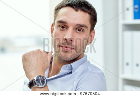 business, people and work concept - portrait of businessman in office