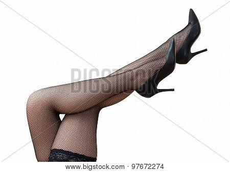 Sexy Female Legs In Black Tights And Shoes Raised Up.