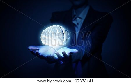 Brain in hand or save intelligence concept