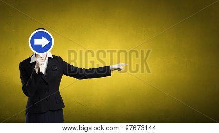 Unrecognizable businesswoman hiding her face behind mask