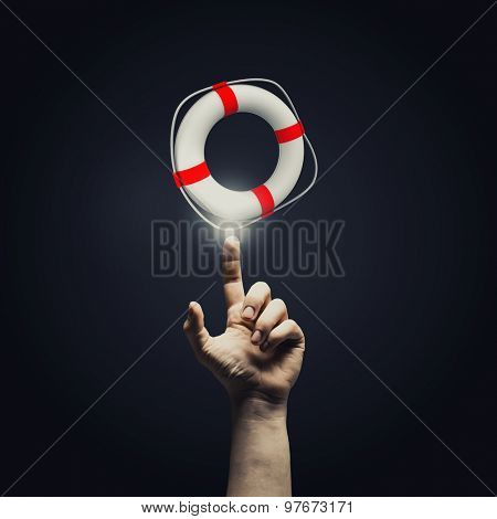 Close up of male hand pointing at buoy symbol