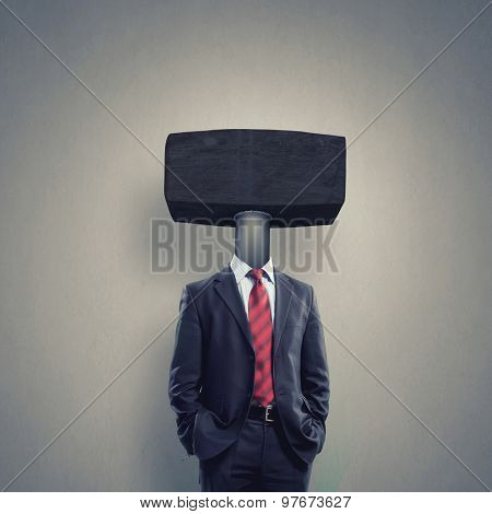 Headless businessman with hamer instead of head