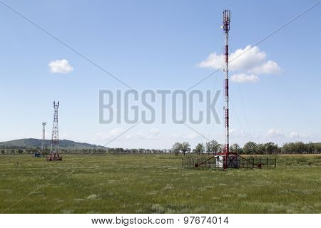 Telecommunication towers in sunny summer day