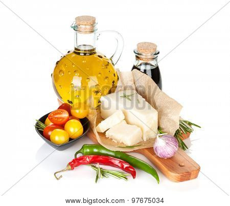 Parmesan cheese, tomatoes, herbs and spices. Isolated on white background