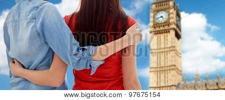 people, homosexuality, same-sex marriage, travel and gay love concept - close up of happy women couple hugging over big ben tower background