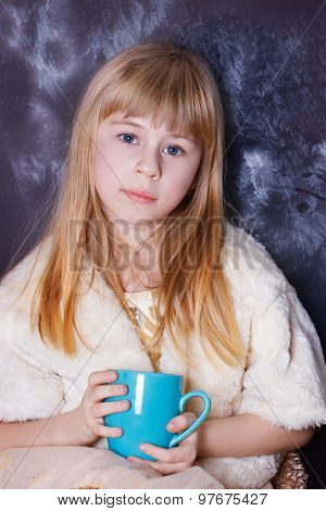 Girl 5 years sits near a window covered with frost