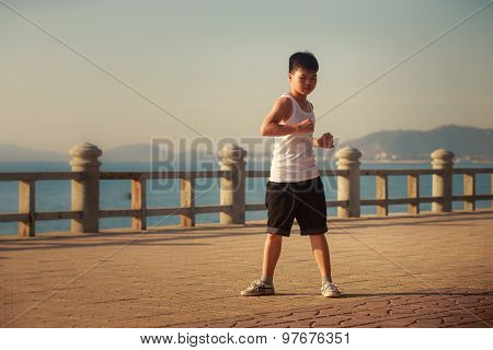 Vietnamese Boy Turns Around On Embankment At Dawn