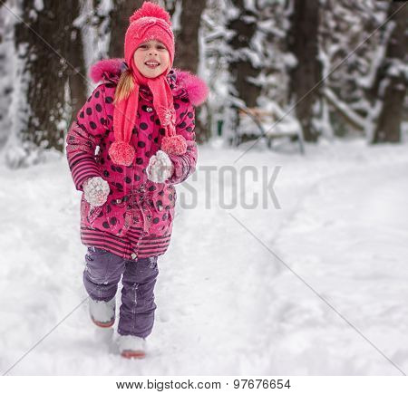 Happy 5 year old girl running on snow