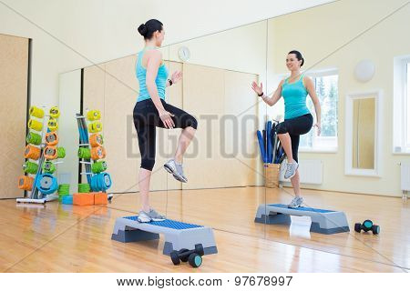 Beautiful Slim Woman Working Out With Stepper In Gym